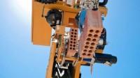 """Robô """"pedreiro"""" instala tijolos e constrói casas em 2 dias"""